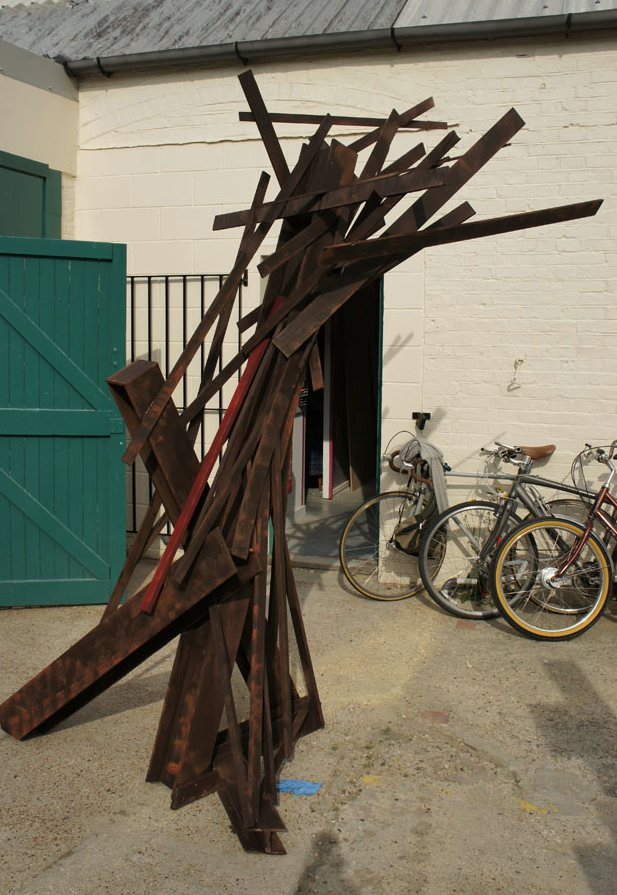 Pseudo steel structures created out of recycled wood and cardboard