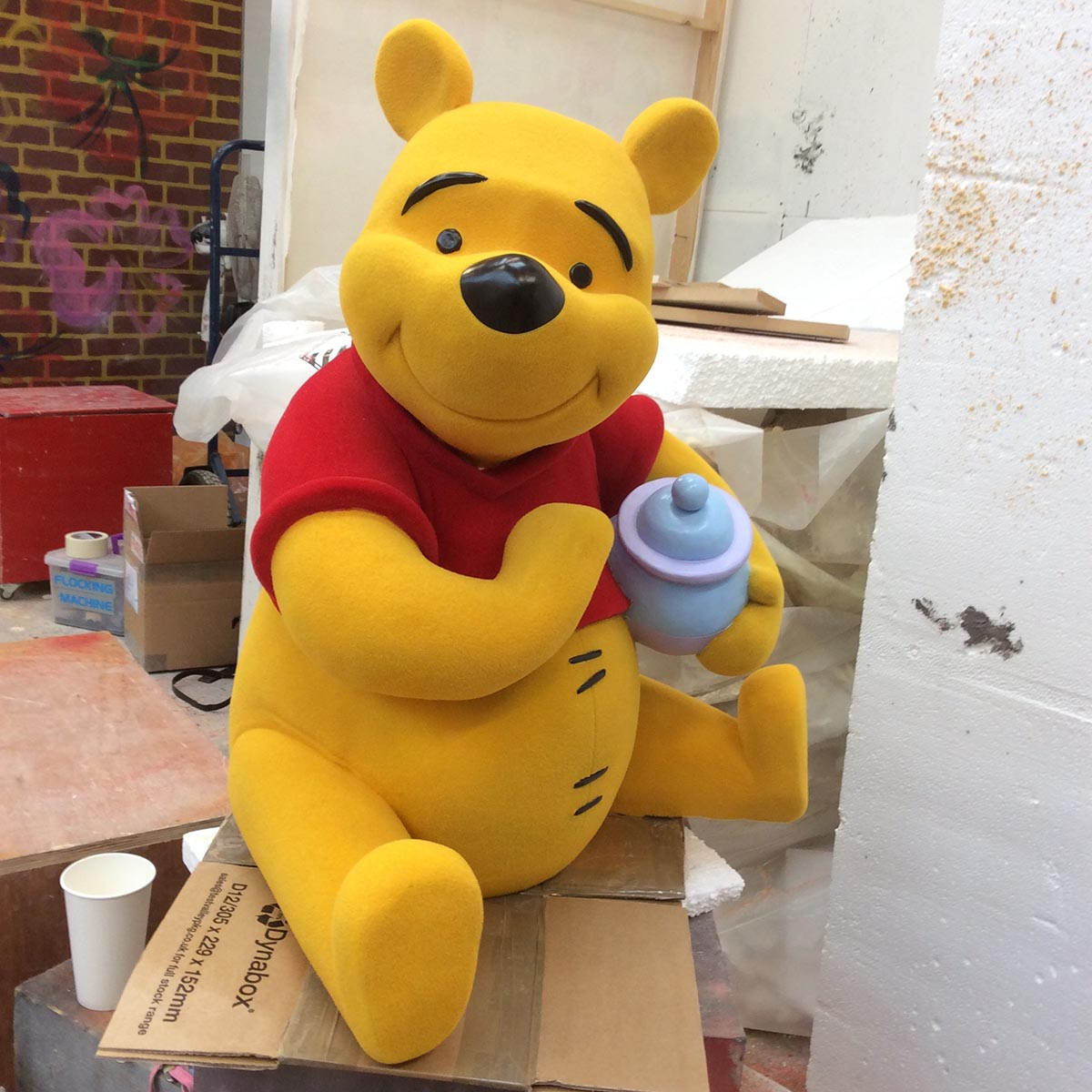 Winnie the Pooh flocked sculpture